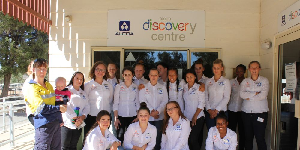 Alcoa mechanical engineer Paula West and baby daughter Karla with the iWomen girls at Alcoa Discovery Centre, Pinjarra.