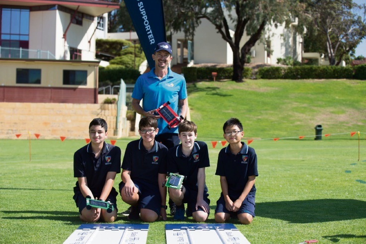 Churchlands SHS year 8 students Nic Ellitt, Will Ramonell, Elliot King and Jeremy Keng with their solar-powered model car and Synergy energy solutions manager Allen Gerber.