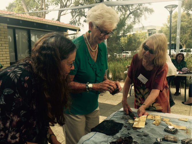 Louise Helfgott, Bev Jackson and Jill Millican check out the results of their ecodyeing efforts.