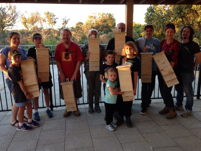 Community members build nest boxes for the bats to help the species. Picture: Supplied