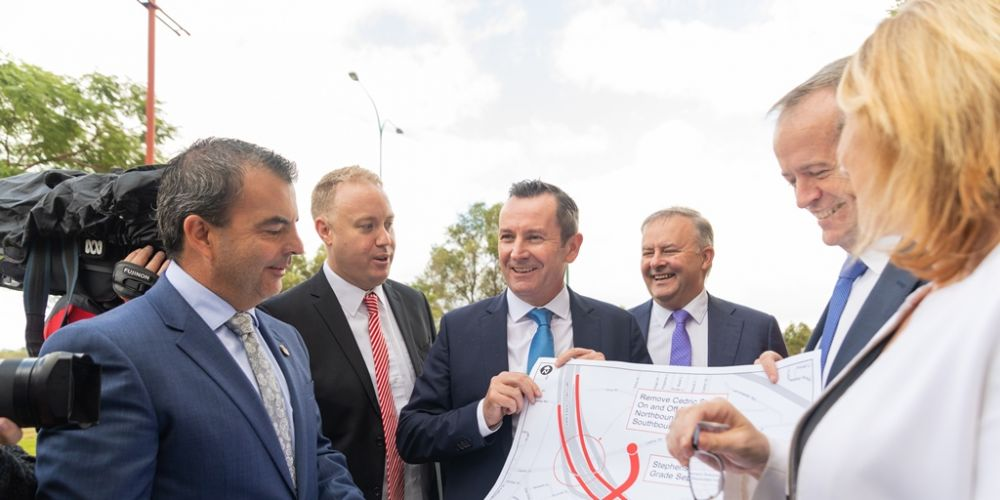 Stirling Mayor Mark Irwin, Balcatta MLA David Michael, Premier Mark McGowan, Federal Opposition infrastructure spokesman Anthony Albanese, Federal Opposition leader Bill Shorten and State Transport Minister Rita Saffioti look at plans for the Stephenson Avenue extension.