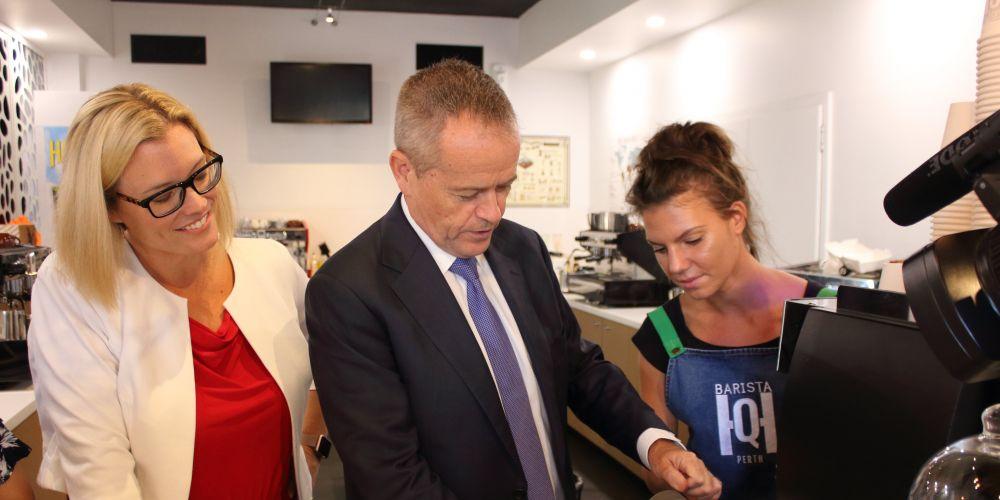 Hannah Beazley and Bill Shorten under the watchful eye of barista Vanessa Krupianka.