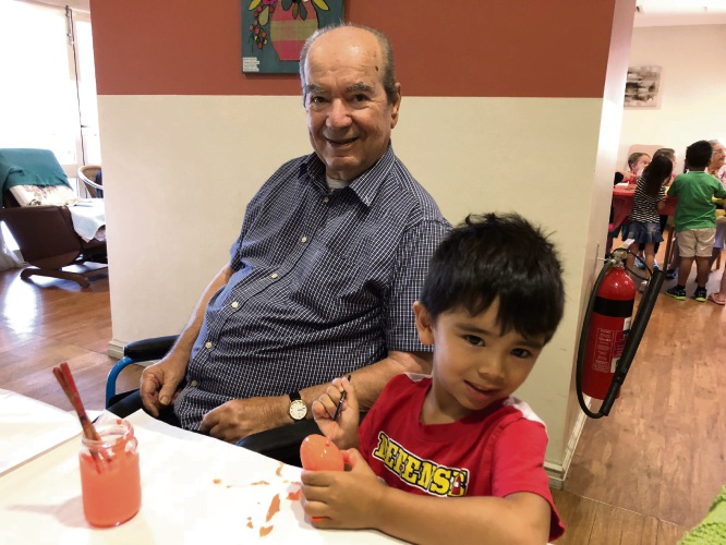 Resident Vince Nocciolino and Kindy student Eli.