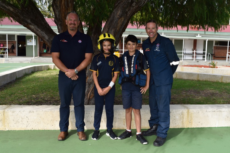 Surf Life Saving WA aerial surveillance lifesaving officer Andrew Rogers, Embleton Primary School student councillors Lidia Mjaissir and Duncan Eathorn and Fremantle rescue crew chief Scott Hardstaff.