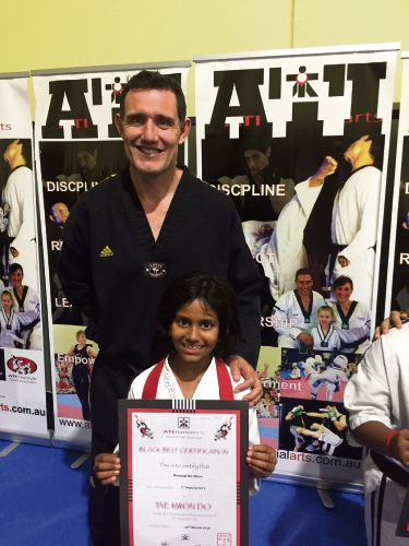 Ranugi DeSilva (8) with taekwondo instructor Tony Curtis.
