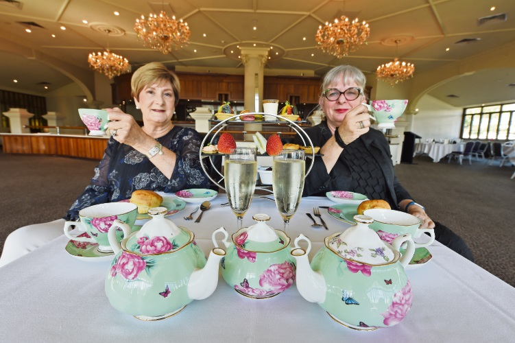Starick chairwoman Wendy Wiley and chief executive Leanne Barron get ready for the high tea. Picture: Jon Hewson