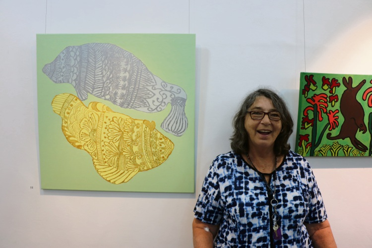 Artist Carolyn Kelly with her artwork Circle of Fish In Focus exhibition 2018. Picture: Supplied