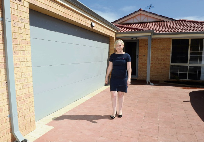 DHA defence communications manager Virginia Tapia walk outside the renovated homes. Pictures: Jon Bassett
