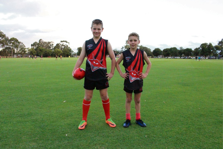 Belmont Junior Football Club Tait Dalton and Ryan Sheridan (9) in the club's new jerseys. Picture: Aaron Corlett