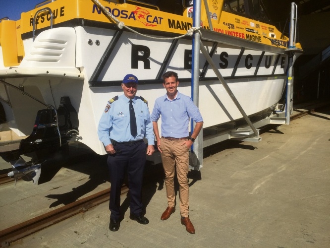Mandurah Mayor Rhys Williams and Mandurah Volunteer Marine Rescue Commander John Blay in front of one of the group's rescue boats.