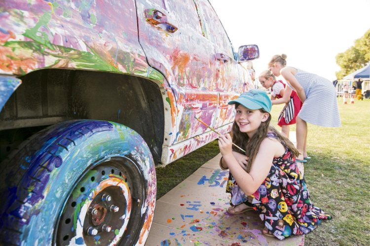 Haylee Patchett showing her paint skills in the paint-a-car workshop.