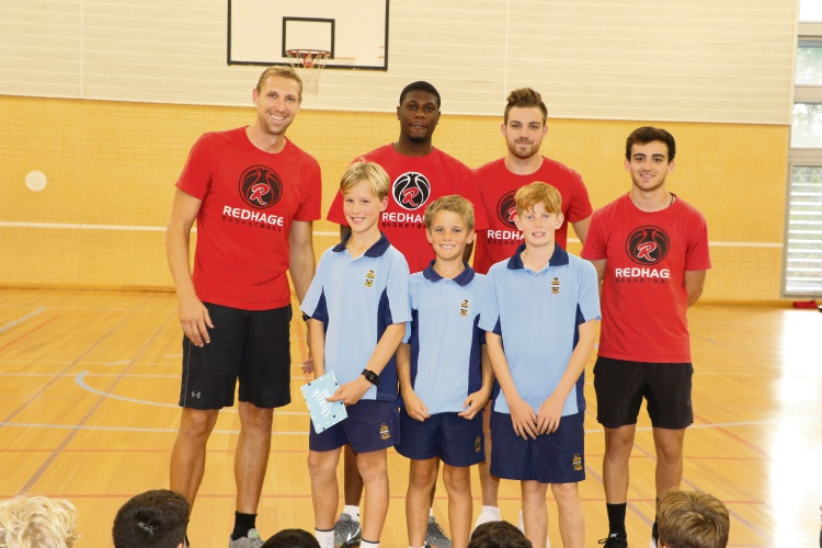 Hale School Year 6 students Jed Hewitt, Lachlan Steele and Isaac Katz with Shawn Redhage and coaches Maurice Barrow, Cooper Hamilton and Matt Giorgi at the basketball clinic.