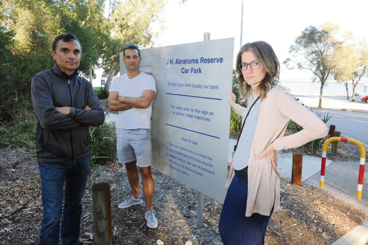 Petitioner Emiliya Peneva (right), windsurfer Nikolai Dimitrov (centre) and kitesurfer Dean Babic (left) are fighting 24-7 parking fees at JH Abrahams Reserve in Crawley. Pictures: Jon Bassett