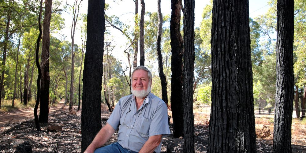 Ian Johnston feared a repeat of the Parkerville fires when powerlines came down near his home. Picture: David Baylis.