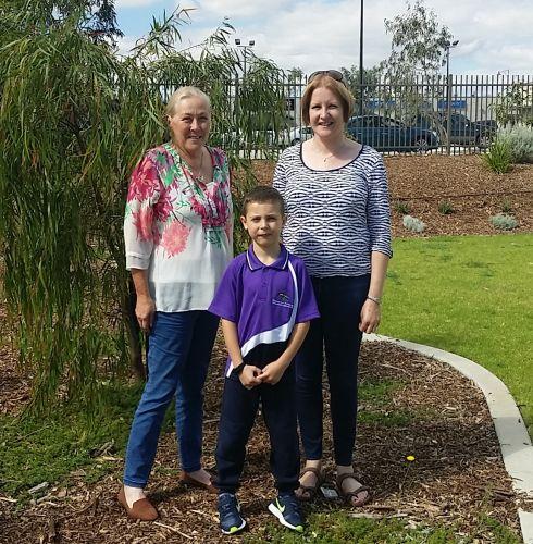 Community garden group members Roberta Dinnie, Emmerson Axiotis and Anita Axiotis.