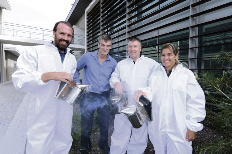 Such a buzz Stewart Clarke from Boddington Yanchep resident Daniela Boksjo trainer David Currey and Shane Dinsdale of Parkerville are some of the students attending WA's first beekeeper program
