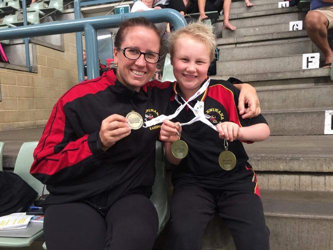 Kwinana Swimming Club head coach Kareena Preston and triple gold medallist Alexey Ulupov (9).