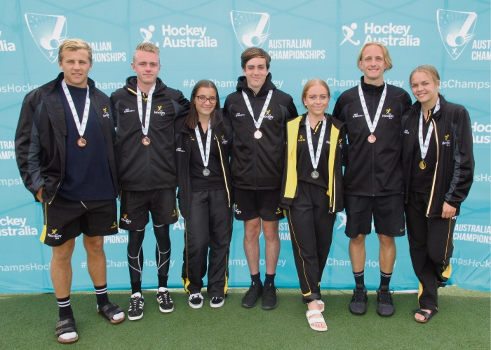 Melville City Hockey Club's Kyle Potter, Wes Stewart, Jo Snyman, Mitchell Tate, Jade Vanderzwan, Justin Schonken and Neasa Flynn helped guide WA to medals at the Under-18 National Championships in Launceston.