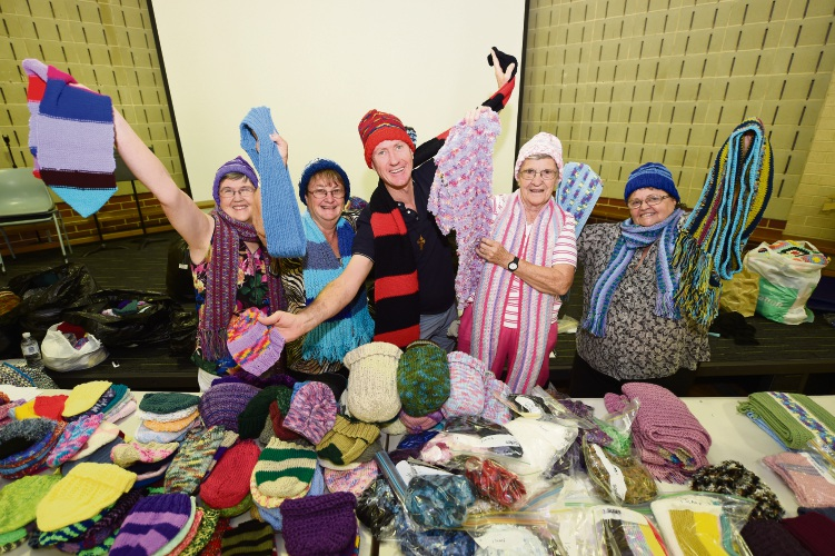 Linda Trefry, Lyn Butcher, Father Bruce Hyde, Rosalie Chadwick and Robyn Ricket at the Annual Charity Knit-In on Monday.
