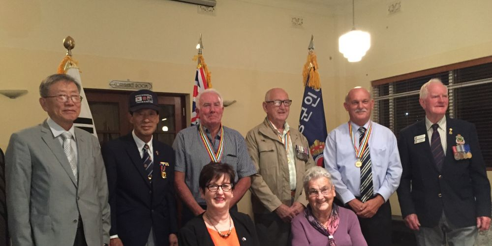 Korean War veterans and their families were presented with the Ambassador of Peace Medal.