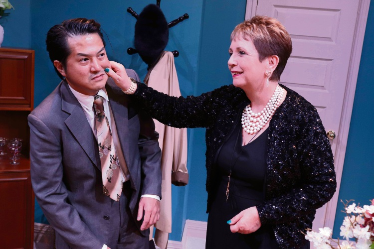 Jacqui Warner, right, stars as the overbearing mother of Tom, played by Benedict Chau.