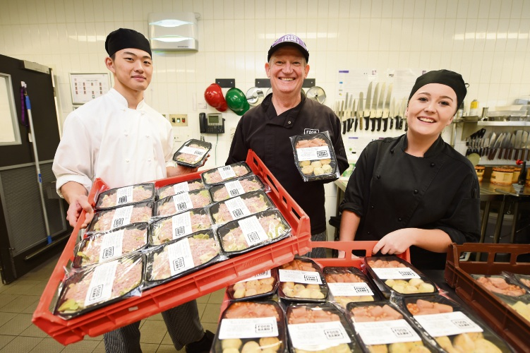Apprentice chefs Jason Tan and Erin Kerr help out Foodbank WA commercial kitchen manager Grant Longman. Picture: Jon Hewson d481847