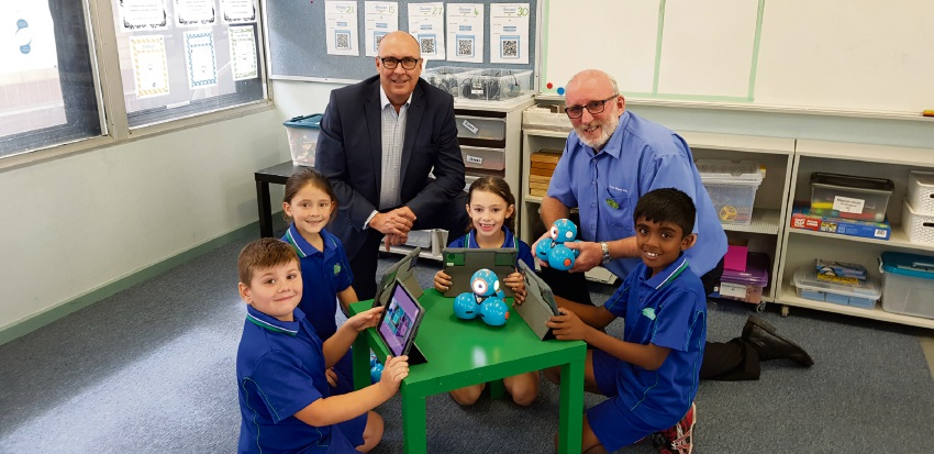 Tianqi Lithium Australia general manager Phil Thick, Bertram Primary School principal Geoff Hood and Bertram Primary School students.