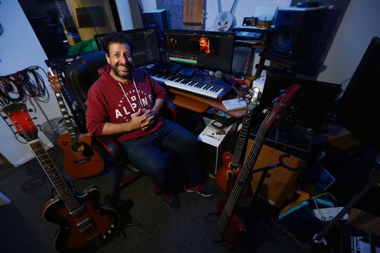 Former music producer Peter Renzullo is currently shooting his first film about the music industry – despite being legally blind. Picture: Andrew Ritchie.