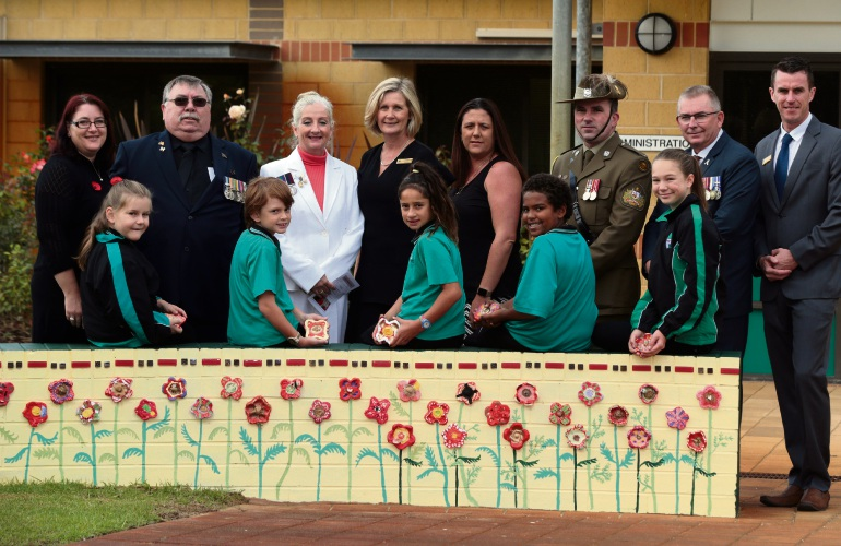 Kristy McDonnell, veteran Arthur Ventham, Wanneroo Mayor Tracey Roberts, principal Tracey Renton, Tania Stern, Warrant Officer Class One Bruce Williams, MLA Mark Folkard and students Sarah O'Donnell, Braydan Saunders, Milla Yates, Brayden Riddell and Jessica Smith. Picture: Martin Kennealey d481697