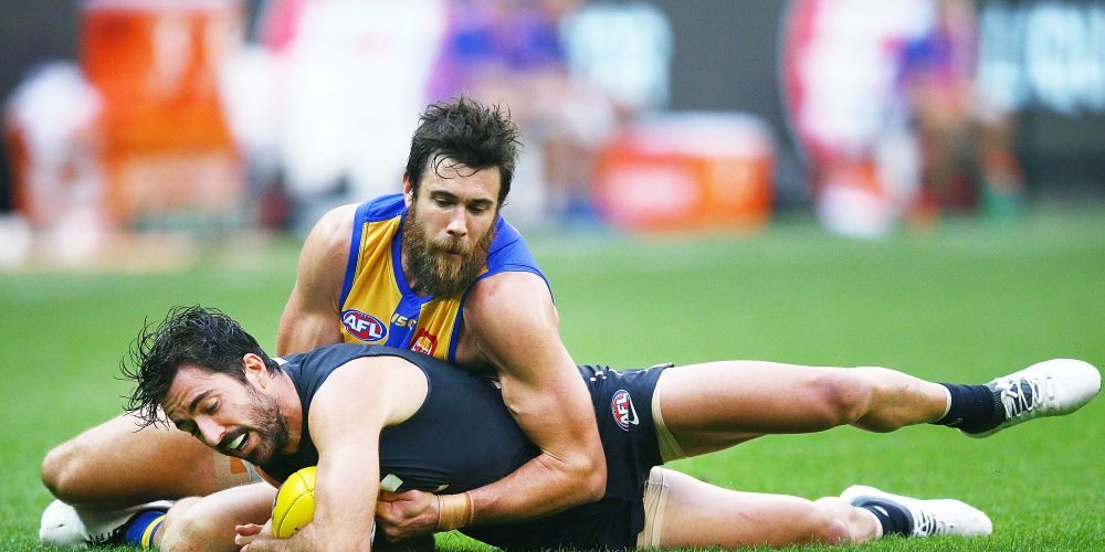 Josh Kennedy tackles Kade Simpson of the Blues. Picture: Michael Dodge/Getty Images