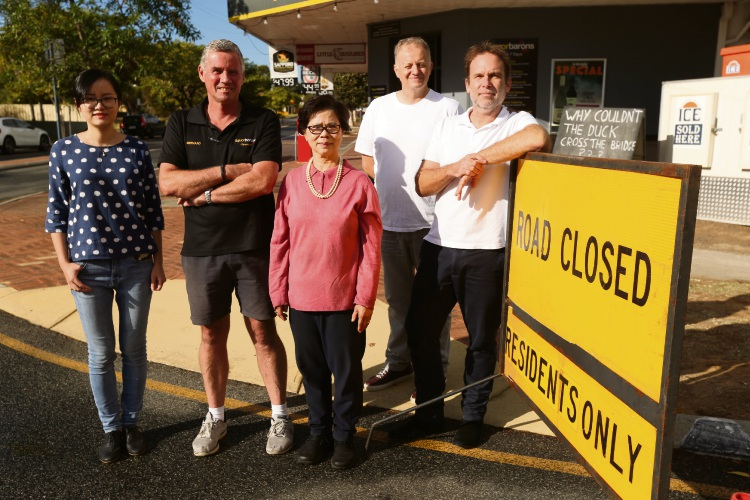 Aston Avenue traders (l-r) Ellie Liu (dots), Bernard Hubbard (black) Thi Nhon-Nguien (pink), Steven Crane (white tall), and Denis Winter (white shorter) say they are struggling because of a combination of road works.  Picture: Andrew Ritchie.