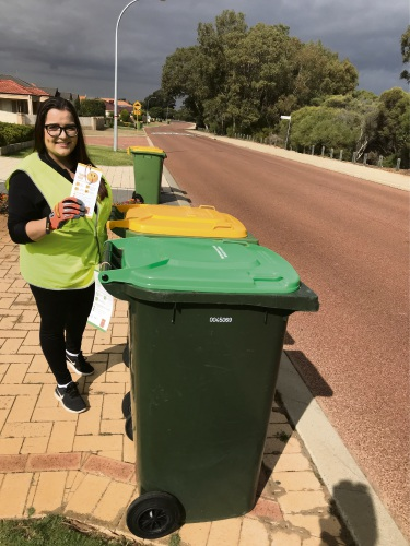 Waste education officer Maddison Vause educates community members on disposing their waste correctly.