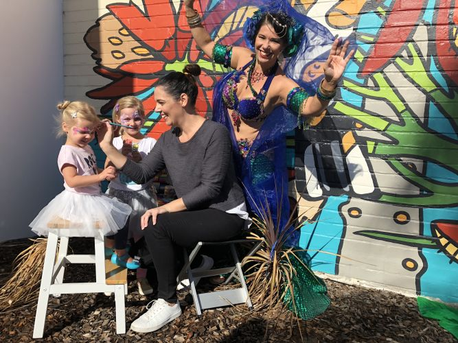 Ivy (3), Mila (5) and Niki Tulloch from Nix Face Painting and Inglewood resident Jennah from Belly Dance Bombshells.