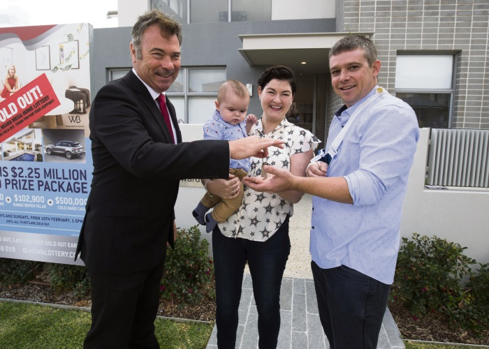 MSWA chief executive Marcus Stafford hands over the keys to Merriwa couple Aileen O'Toole and David Walsh and their seven-month-old son Peter.