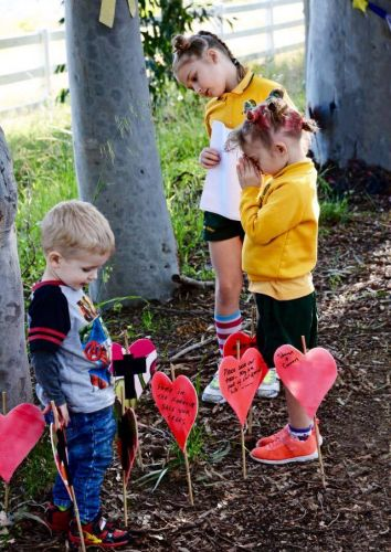 Three young supporters who are trying to save the potential destruction of 14 trees in Wattle Grove. Photo: Ray Thompson.
