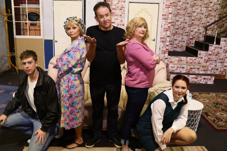 John Smith (Gordon Park, centre) finds his life with two wives has become even more complicated now children are involved: Gavin (Josh Flaherty), Barbara (Colleen Hopkins), Mary (Fiona Forster) and Vicki (Jenna McGougan-Shaw).