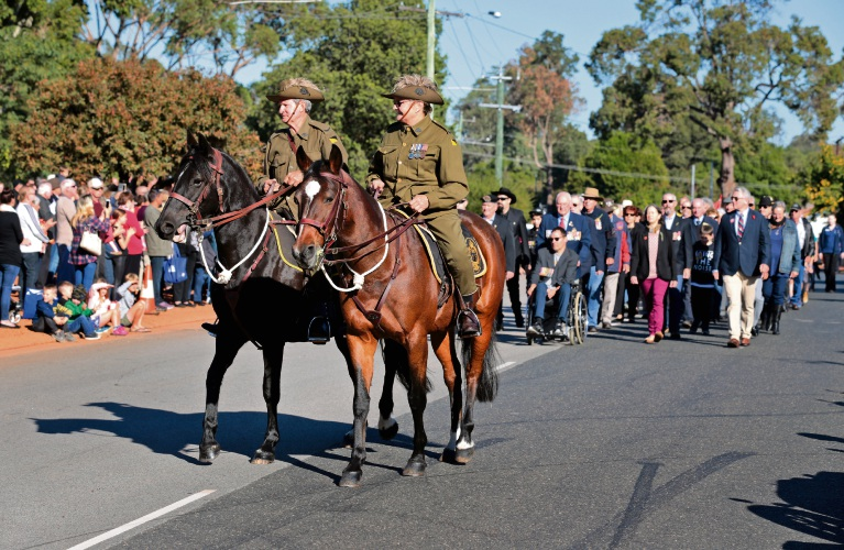Erika and Brian Hancock on horseback wearing the uniform of the 10th Light Horse Regiment during the march. Chidlow Anzac Service.  Photo: David Baylis