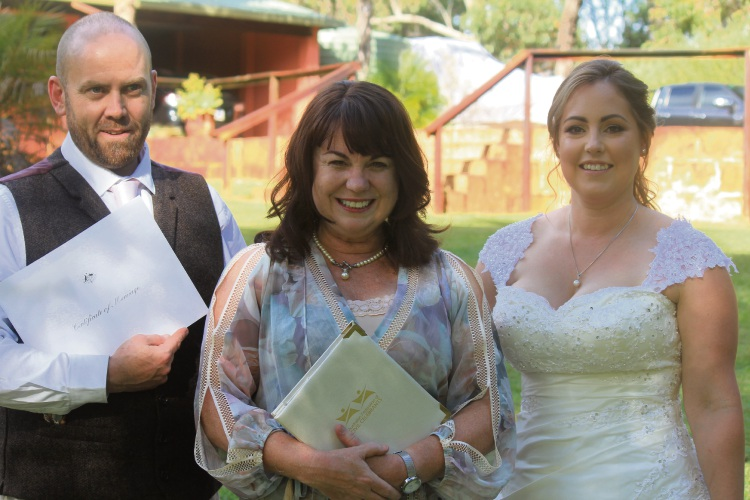 Paul Watters and Lisa Guthrie-Watters with marriage celebrant Kylee Payne.