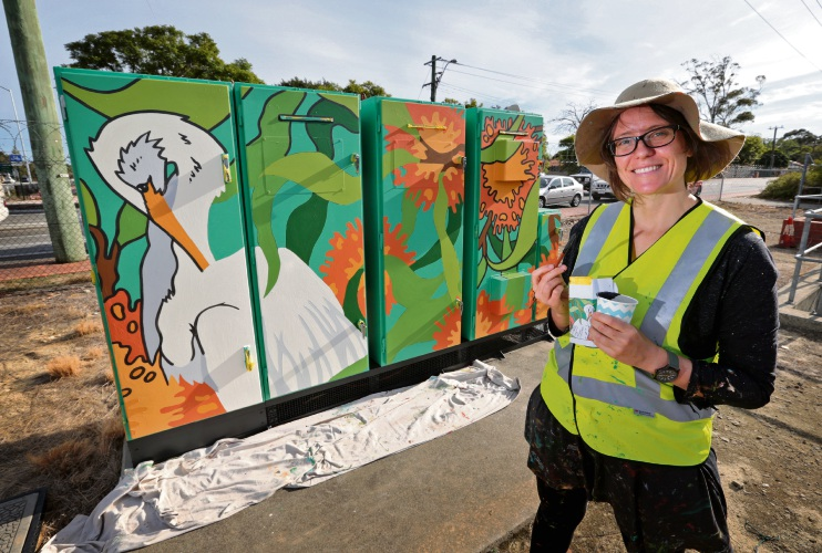 Mel McVee of Fremantle. Mel is a community mural artist and is painting a water/wastewater electrical cabinet as part of Water Corporation's Splash of Colour program. This cabinet is on the corner of Tonkin Hwy and Hale Road in Forrestfield. Picture: David Baylis d482156