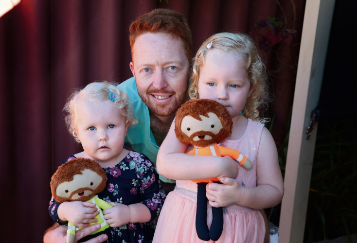Shannon Veivers (Butler) with his daughters Elliott (1) and Charlotte (3) with their FIFO dolls made by Cutie Hooties. Pictures: Martin Kennealey d482047