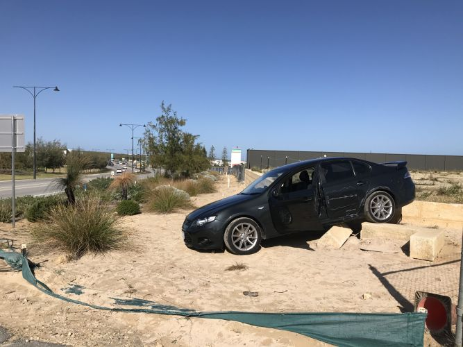 A stolen black Ford XR6 left abandoned in Jindalee. Pictures: Martin Kennealey