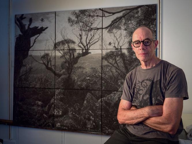 Nigel Hewitt in front of his work, Ghosts on the Tarn Shelf.