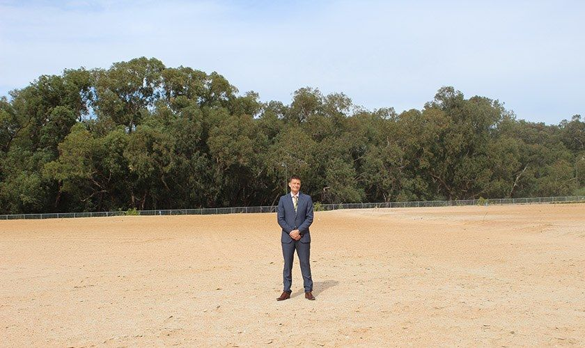 Paul Dyer standing on the site of the new St John of God Private Hospital in Midland.