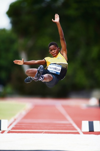 Ife Okiwelu leaps for gold in the long jump.