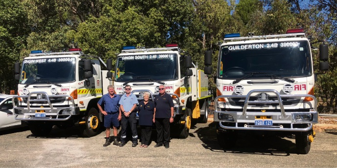 Chief Bush Fire Control Officer Phil Barrett (in uniform) with fire brigade volunteers Murray Hyne, Carolee Peace and Grahame Rivers with the brand new fire trucks.