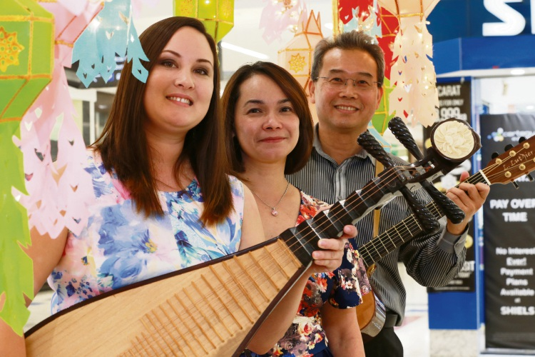 L-R Sarah Long (with pipa, a Chinese instrument), Judith Tan (singer), Australia) and Boon Tan (guitarist), all from the Buddhist Council of Western Australia. Picture: Andrew Ritchie www.communitypix.com.au   d482426