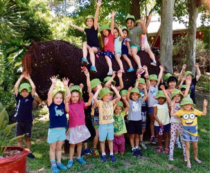 Children at Pachamama celebrate the news the centre will be able to continue operating as normal.