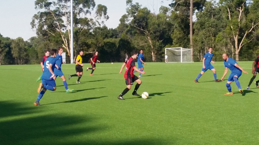 Daniel Davey surges forward against Canning City's defence.