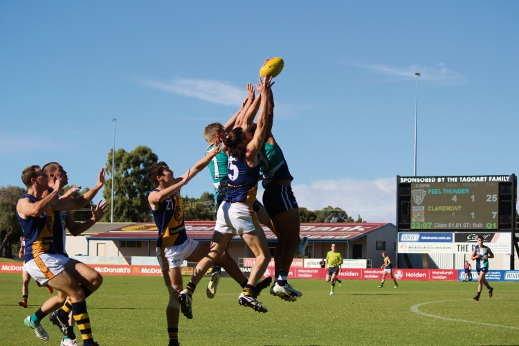 Players fly for the footy. Photo by Vanessa Schmitt.