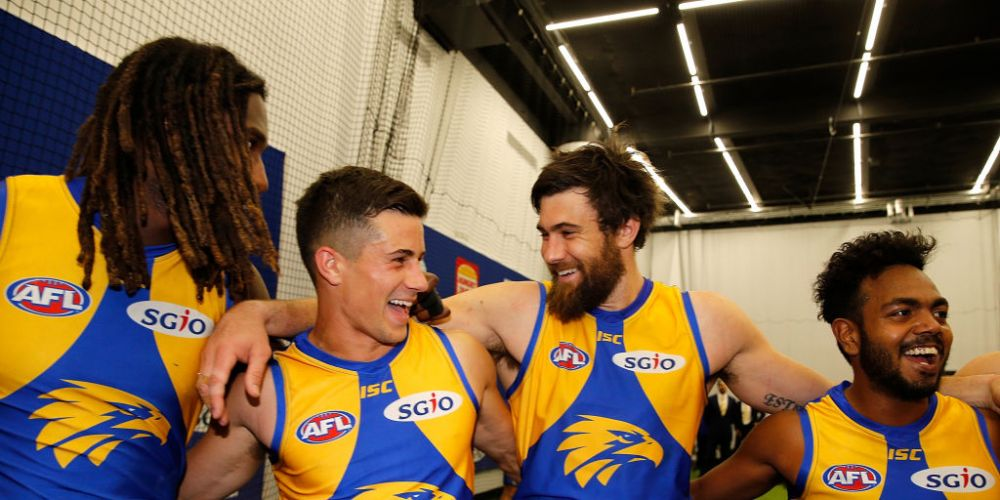 Josh Kennedy celebrates with teammates after  West Coast's win over Port Adelaide at Optus Stadium on Saturday. Picture: Getty Images